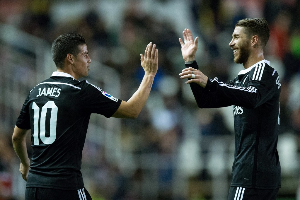MADRID, SPAIN - APRIL 08: James Rodriguez (L) of Real Madrid CF celebrates scoring their second goal Sergio Ramos (R) during the La Liga match between Rayo Vallecano de Madrid and Real Madrid CF at Vallecas Stadium on April 8, 2015 in Madrid, Spain. (Photo by Gonzalo Arroyo Moreno/Getty Images)