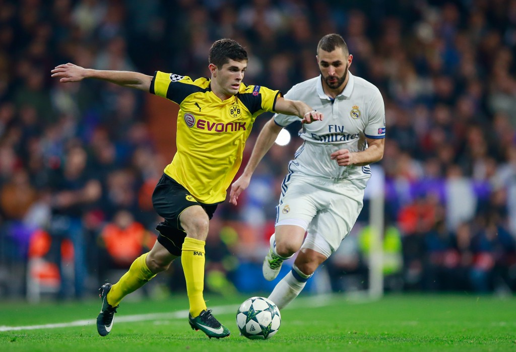 MADRID, SPAIN - DECEMBER 07: Christian Pulisic of Borussia Dortmund (L) and Karim Benzema of Real Madrid (R) battle for possession during the UEFA Champions League Group F match between Real Madrid CF and Borussia Dortmund at the Bernabeu on December 7, 2016 in Madrid, Spain. (Photo by Gonzalo Arroyo Moreno/Getty Images)