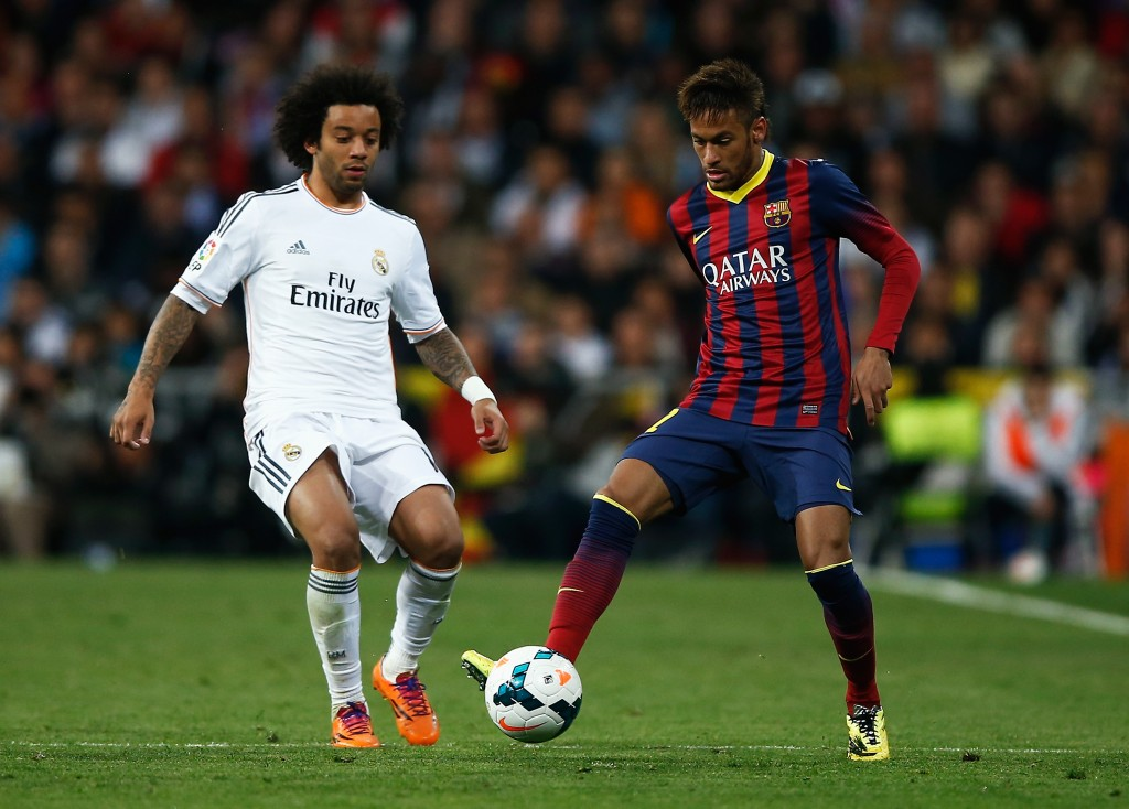 MADRID, SPAIN - MARCH 23: Neymar of Barcelona is closed down by Marcelo of Real Madrid during the La Liga match between Real Madrid CF and FC Barcelona at the Bernabeu on March 23, 2014 in Madrid, Spain. (Photo by Gonzalo Arroyo Moreno/Getty Images)