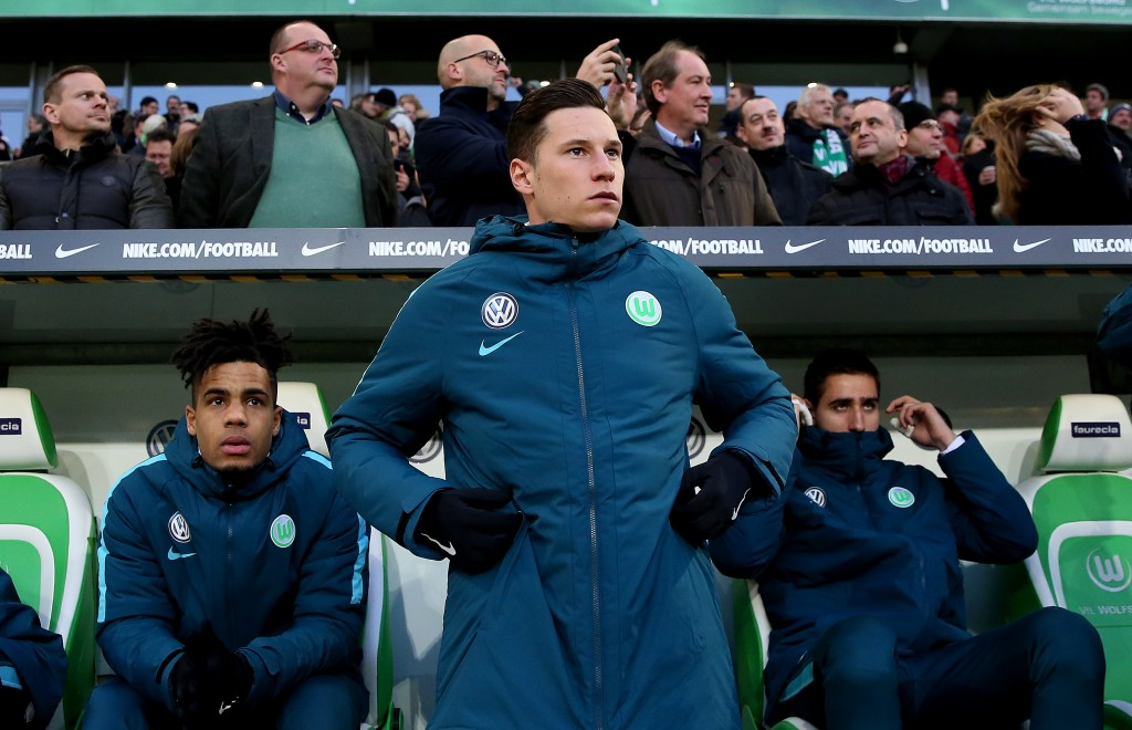 WOLFSBURG, GERMANY - DECEMBER 03: Julian Draxler (C) of Wolfsburg stands infront of the bench prior to the Bundesliga match between VfL Wolfsburg and Hertha BSC at Volkswagen Arena on December 3, 2016 in Wolfsburg, Germany. (Photo by Ronny Hartmann/Bongarts/Getty Images)