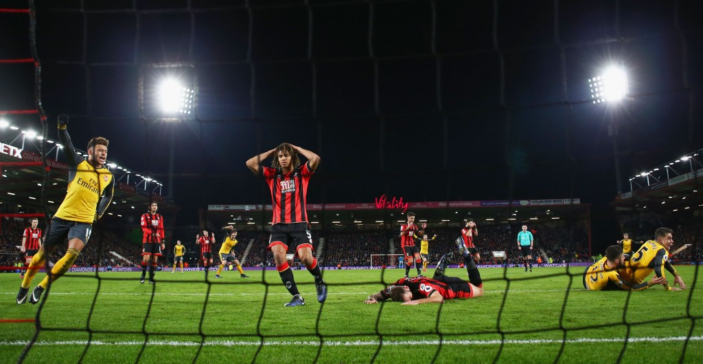 BOURNEMOUTH, ENGLAND - JANUARY 03: Nathan Ake (C-L) of AFC Bournemouth after Olivier Giroud (2nd R) of Arsenal scoring the third goal during the Premier League match between AFC Bournemouth and Arsenal at Vitality Stadium on January 3, 2017 in Bournemouth, England. (Photo by Michael Steele/Getty Images)