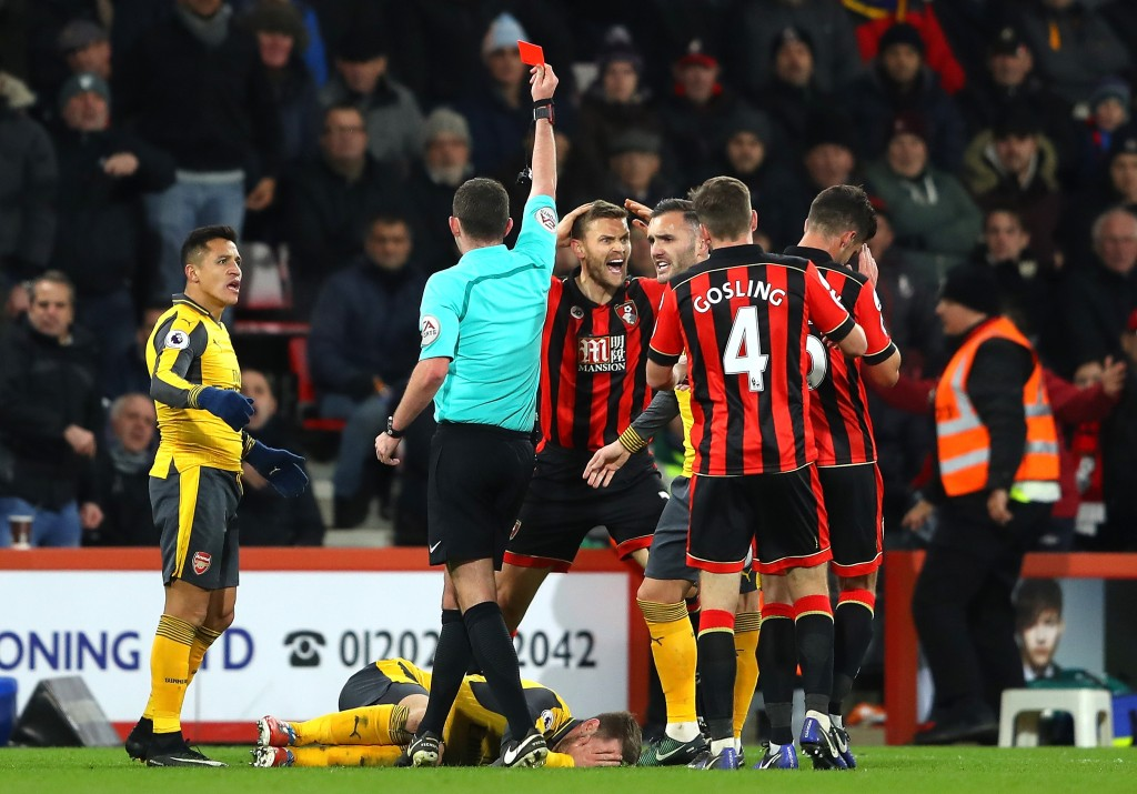 BOURNEMOUTH, ENGLAND - JANUARY 03: Simon Francis (4th R) of AFC Bournemouth reacts after receiving a red card by referee Michael Oliver (2nd L) after tackling on Aaron Ramsey of Arsenal during the Premier League match between AFC Bournemouth and Arsenal at Vitality Stadium on January 3, 2017 in Bournemouth, England. (Photo by Warren Little/Getty Images)