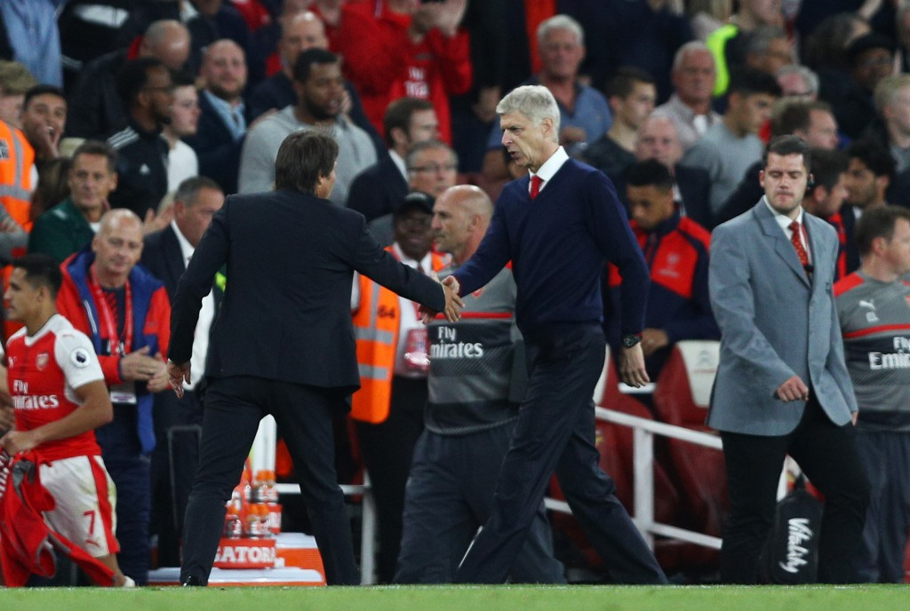 LONDON, ENGLAND - SEPTEMBER 24: Antonio Conte, Manager of Chelsea (L) and Arsene Wenger, Manager of Arsenal (R) shake hands after the final whistle during the Premier League match between Arsenal and Chelsea at the Emirates Stadium on September 24, 2016 in London, England. (Photo by Paul Gilham/Getty Images)