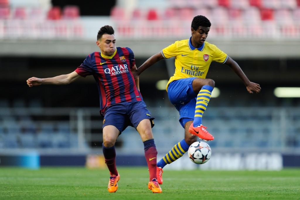 BARCELONA, SPAIN - MARCH 18: Gedion Zelalem of Arsenal duels for the ball with Munir El Haddadi of FC Barcelona during the UEFA Youth League Quarter FInal match between FC Barcelona U19 and Arsenal U19 at Mini Estadi on March 18, 2014 in Barcelona, Spain. (Photo by David Ramos/Getty Images)