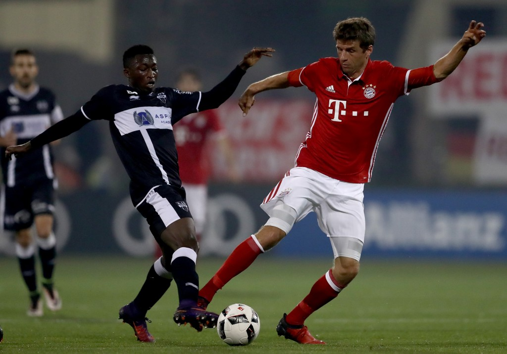 DOHA, QATAR - JANUARY 10: Amani Lazare of Eupen challenges Thomas Mueller of Muenchen during the friendly match between Bayern Muenchen and KAS Eupen on January 10, 2017 in Doha, Qatar. (Photo by Lars Baron/Bongarts/Getty Images)