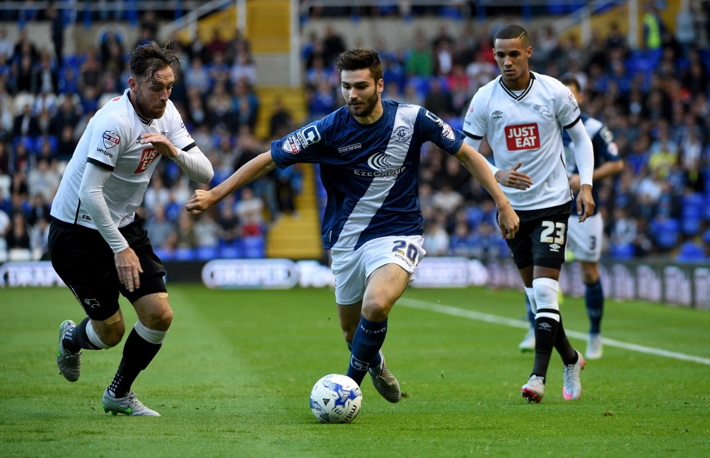 BIRMINGHAM, ENGLAND - AUGUST 21: Jon Toral of Birmingham is challenged by Richard Keogh of Derbt during the Sky Bet Championship match between Birmingham City and Derby County at St Andrews (stadium) on August 21, 2015 in Birmingham, England. (Photo by Ross Kinnaird/Getty Images)