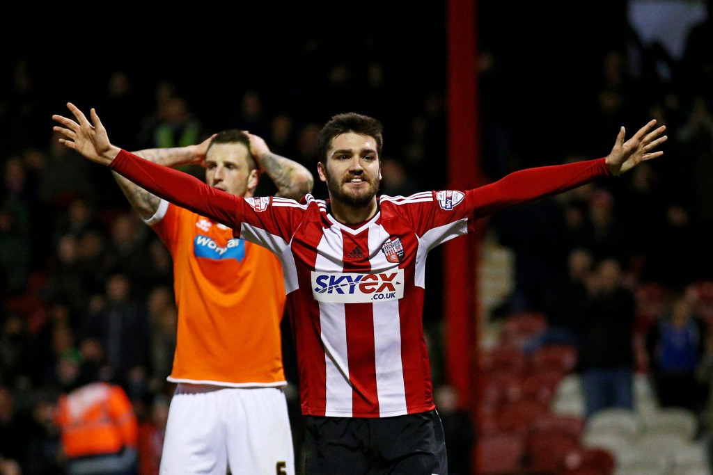 BRENTFORD, ENGLAND - FEBRUARY 24: Jon-Miquel Toral of Brentford celebrates after completing his hat-trick by scoring his team's fourth goal during the Sky Bet Championship match between Brentford and Blackpool at Griffin Park on February 24, 2015 in Brentford, England. (Photo by Paul Gilham/Getty Images)