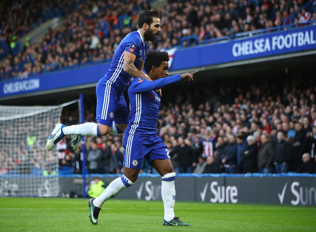 LONDON, ENGLAND - JANUARY 28: Willian (R) of Chelsea celebrates scoring the opening goal with his team mate Cesc Fabregas (L) during the Emirates FA Cup Fourth Round match between Chelsea and Brentford at Stamford Bridge on January 28, 2017 in London, England. (Photo by Clive Mason/Getty Images)