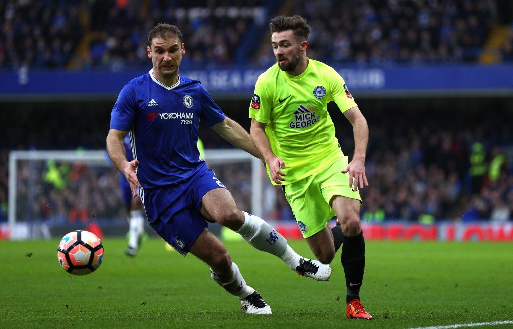 LONDON, ENGLAND - JANUARY 08: Branislav Ivanovic of Chelsea (L) is put under pressure from Gwion Edwards of Peterborough United (R) during The Emirates FA Cup Third Round match between Chelsea and Peterborough United at Stamford Bridge on January 8, 2017 in London, England. (Photo by Ian Walton/Getty Images)