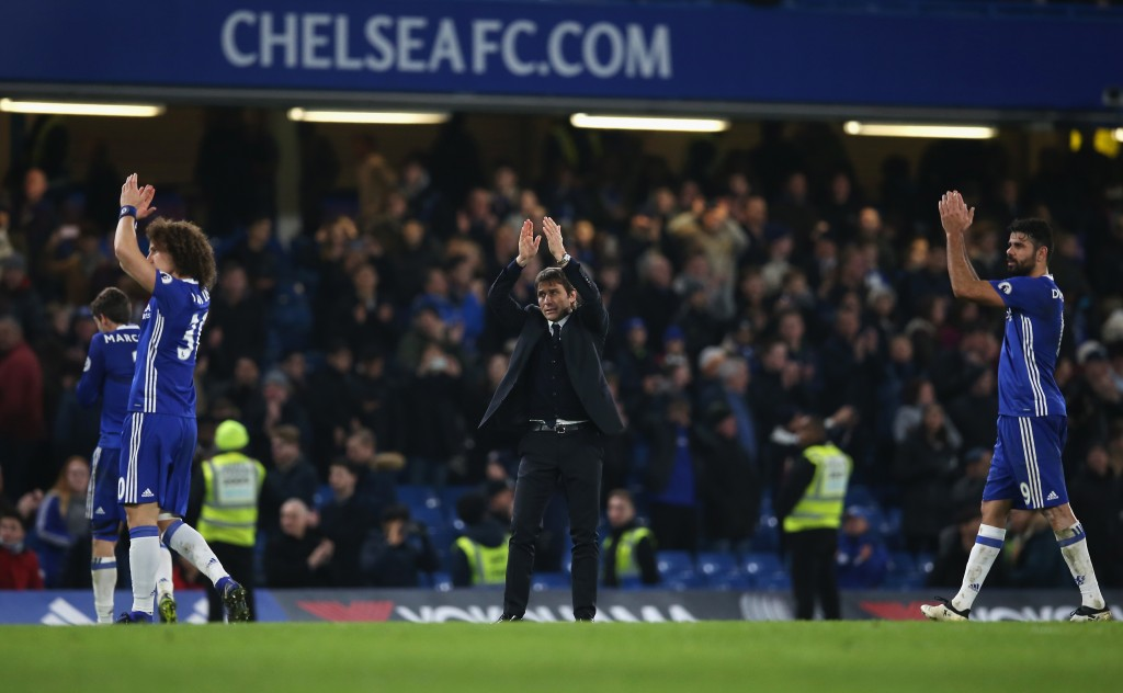 LONDON, ENGLAND - DECEMBER 31: Antonio Conte (C), Manager of Chelsea applauds supporters after the Premier League match between Chelsea and Stoke City at Stamford Bridge on December 31, 2016 in London, England. (Photo by Steve Bardens/Getty Images)