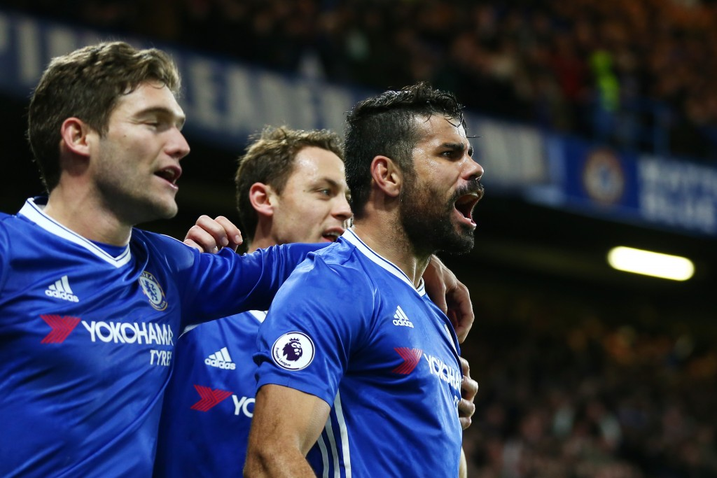 LONDON, ENGLAND - DECEMBER 31: Diego Costa (R) of Chelsea celebrates scoring his team's fourth goal with his team mates during the Premier League match between Chelsea and Stoke City at Stamford Bridge on December 31, 2016 in London, England. (Photo by Steve Bardens/Getty Images)