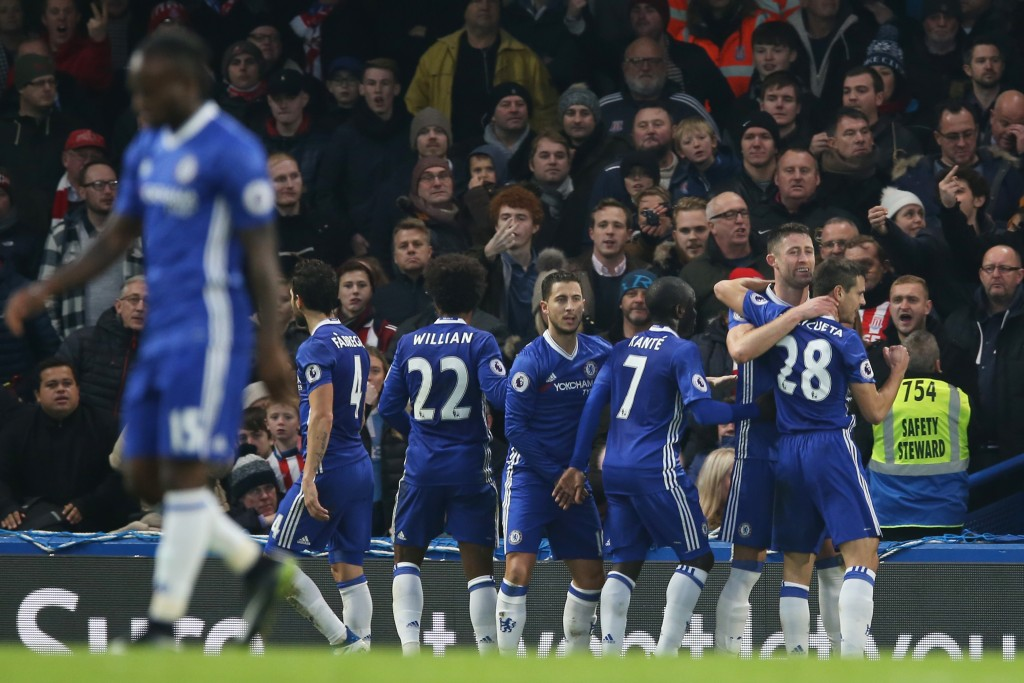LONDON, ENGLAND - DECEMBER 31: Gary Cahill (2nd R) of Chelsea celebrates scoring the opening goal with his team mates during the Premier League match between Chelsea and Stoke City at Stamford Bridge on December 31, 2016 in London, England. (Photo by Steve Bardens/Getty Images)