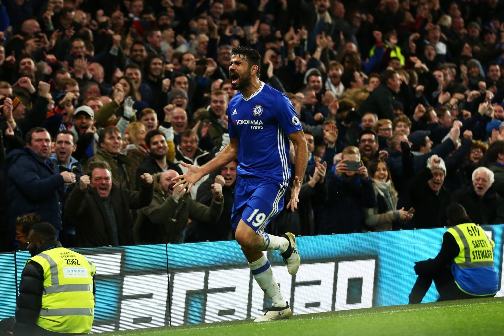 LONDON, ENGLAND - DECEMBER 31: Diego Costa of Chelsea celebrates scoring his team's fourth goal during the Premier League match between Chelsea and Stoke City at Stamford Bridge on December 31, 2016 in London, England. (Photo by Steve Bardens/Getty Images)