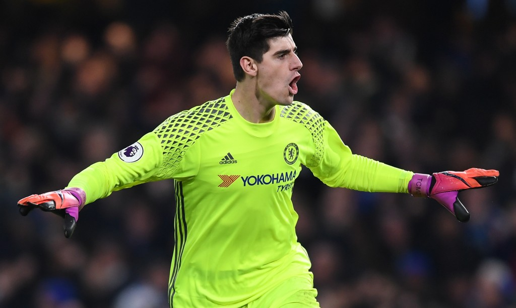 LONDON, ENGLAND - NOVEMBER 26: Thibaut Courtois of Chelsea celebrates his team's second goal during the Premier League match between Chelsea and Tottenham Hotspur at Stamford Bridge on November 26, 2016 in London, England. (Photo by Shaun Botterill/Getty Images)