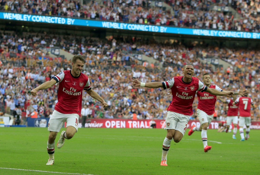 Arsenal's Welsh midfielder Aaron Ramsey (L) celebrates scoring his team's third and winning goal with Arsenal's English defender Kieran Gibbs during the English FA Cup final match between Arsenal and Hull City at Wembly Stadium in London on May 17, 2014. AFP PHOTO/ADRIAN DENNIS NOT FOR MARKETING OR ADVERTISING USE / RESTRICTED TO EDITORIAL USE (Photo credit should read ADRIAN DENNIS,ADRIAN DENNIS/AFP/Getty Images)