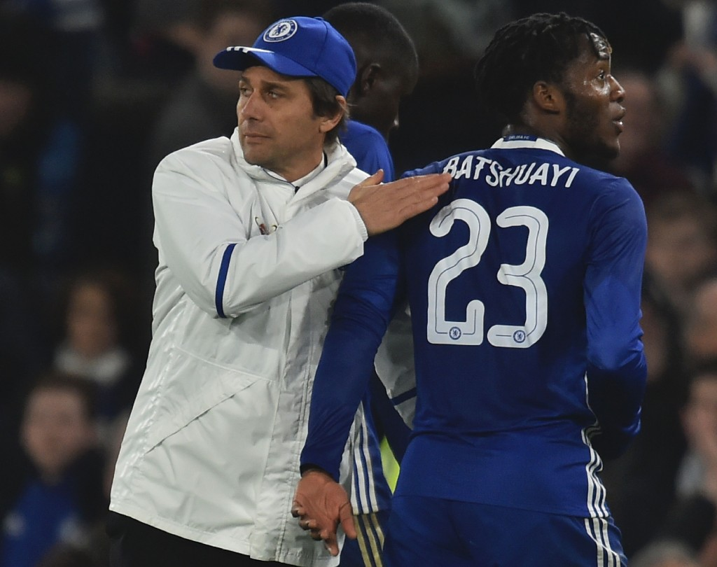 Chelsea's Italian head coach Antonio Conte (L) pats Chelsea's Belgian striker Michy Batshuayi (R) on the back at the end of the English FA Cup third round football match between Chelsea and Peterborough at Stamford Bridge in London on January 8, 2017. (Photo by Glyn Kirk/AFP/Getty Images)