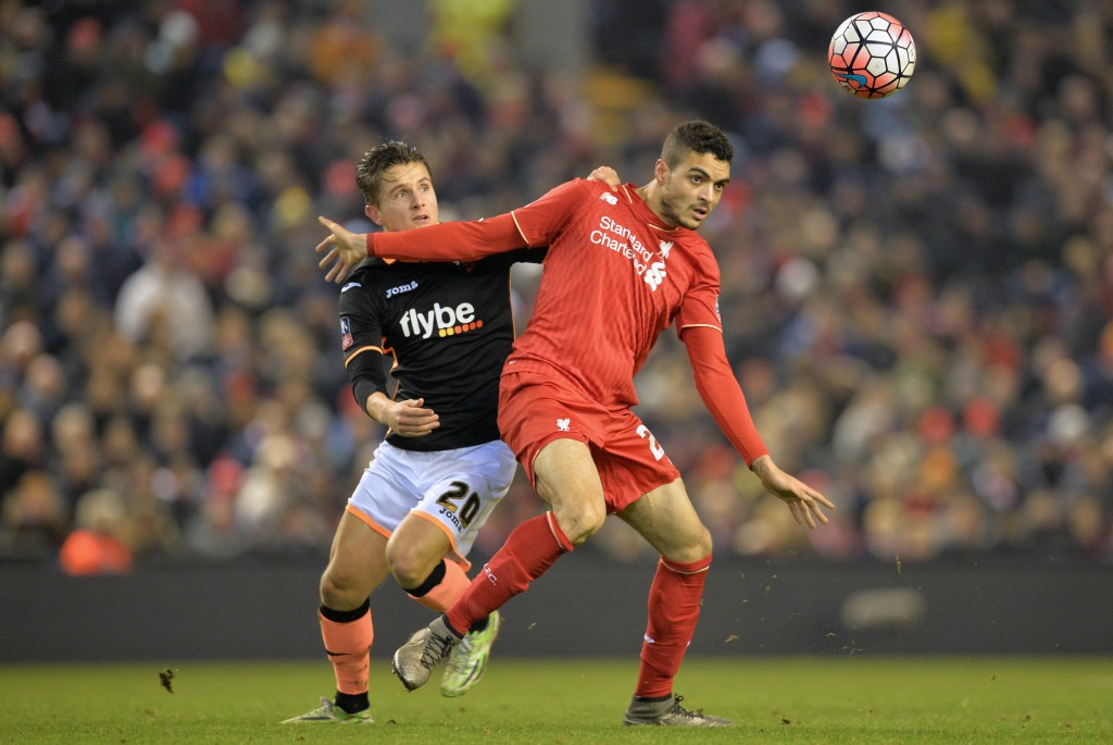 Exeter City's English striker Tom Nichols (L) vies with Liverpool's Portuguese defender Tiago Ilori during the English FA Cup third round replay football match between Liverpool and Exeter City at Anfield in Liverpool, north west England on January 20, 2016. (Photo by Paul Ellis/AFP/Getty Images) RESTRICTED TO EDITORIAL USE. No use with unauthorized audio, video, data, fixture lists, club/league logos or 'live' services. Online in-match use limited to 75 images, no video emulation. No use in betting, games or single club/league/player publications. / AFP / PAUL ELLIS (Photo credit should read PAUL ELLIS/AFP/Getty Images)