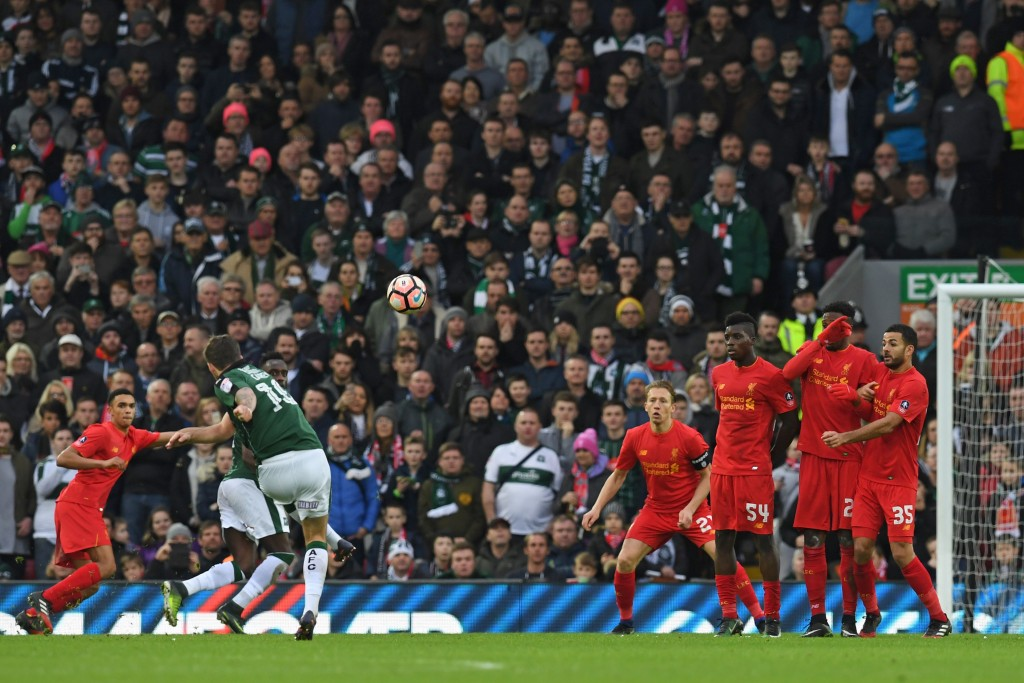Plymouth's Irish midfielder Graham Carey (2nd L) takes a freekick during the English FA Cup third round football match between Liverpool and Plymouth Argyle at Anfield in Liverpool, north west England on January 8, 2017. (Photo by Paul Ellis/AFP/Getty Images)