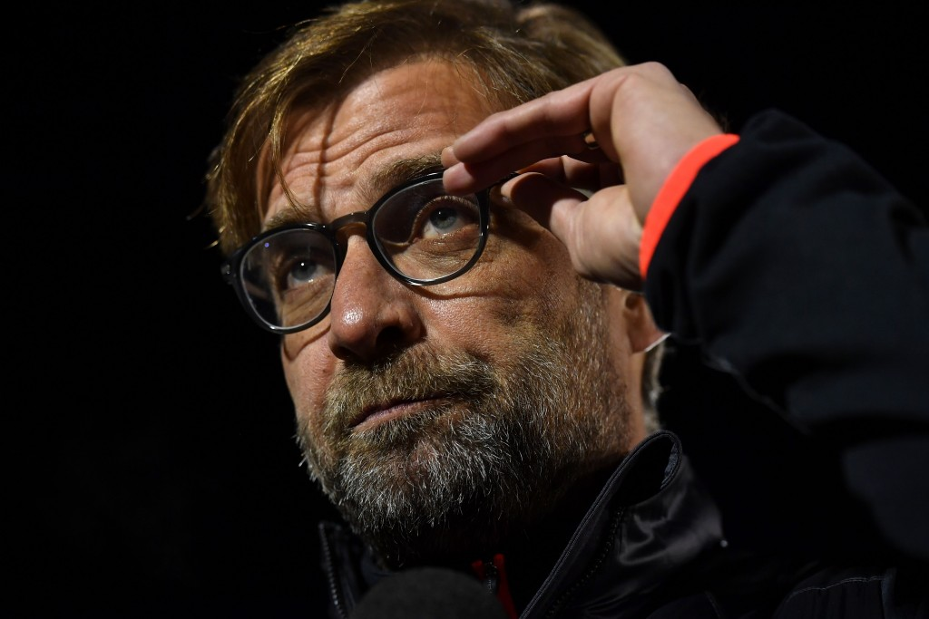 Liverpool's German manager Jurgen Klopp adjusts his glasses as he gives an interview ahead of the English FA Cup third round replay football match between Plymouth Argyle and Liverpool at Home Park in Plymouth, south west England on January 18, 2017. / AFP / Ben STANSALL / RESTRICTED TO EDITORIAL USE. No use with unauthorized audio, video, data, fixture lists, club/league logos or 'live' services. Online in-match use limited to 75 images, no video emulation. No use in betting, games or single club/league/player publications. / (Photo credit should read BEN STANSALL/AFP/Getty Images)