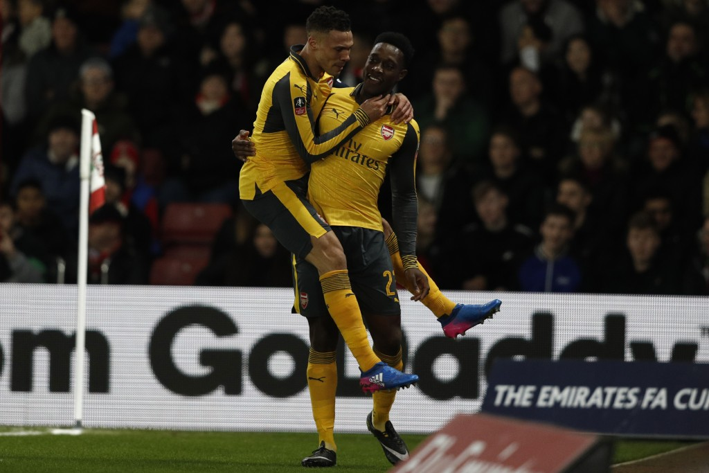 Arsenal's English striker Danny Welbeck (R) celebrates scoring his team's first goal with Arsenal's English defender Kieran Gibbs during the English FA Cup fourth round football match between Southampton and Arsenal at St Mary's in Southampton, southern England on January 28, 2017. / AFP / Adrian DENNIS / RESTRICTED TO EDITORIAL USE. No use with unauthorized audio, video, data, fixture lists, club/league logos or 'live' services. Online in-match use limited to 75 images, no video emulation. No use in betting, games or single club/league/player publications. / (Photo credit should read ADRIAN DENNIS/AFP/Getty Images)
