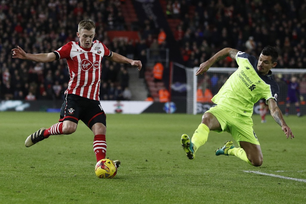 Liverpool's Croatian defender Dejan Lovren (R) tackles Southampton's English midfielder James Ward-Prowse during the EFL (English Football League) Cup semi-final first-leg football match between Southampton and Liverpool at St Mary's Stadium in Southampton, southern England on January 11, 2017. / AFP / Adrian DENNIS / RESTRICTED TO EDITORIAL USE. No use with unauthorized audio, video, data, fixture lists, club/league logos or 'live' services. Online in-match use limited to 75 images, no video emulation. No use in betting, games or single club/league/player publications. / (Photo credit should read ADRIAN DENNIS/AFP/Getty Images)
