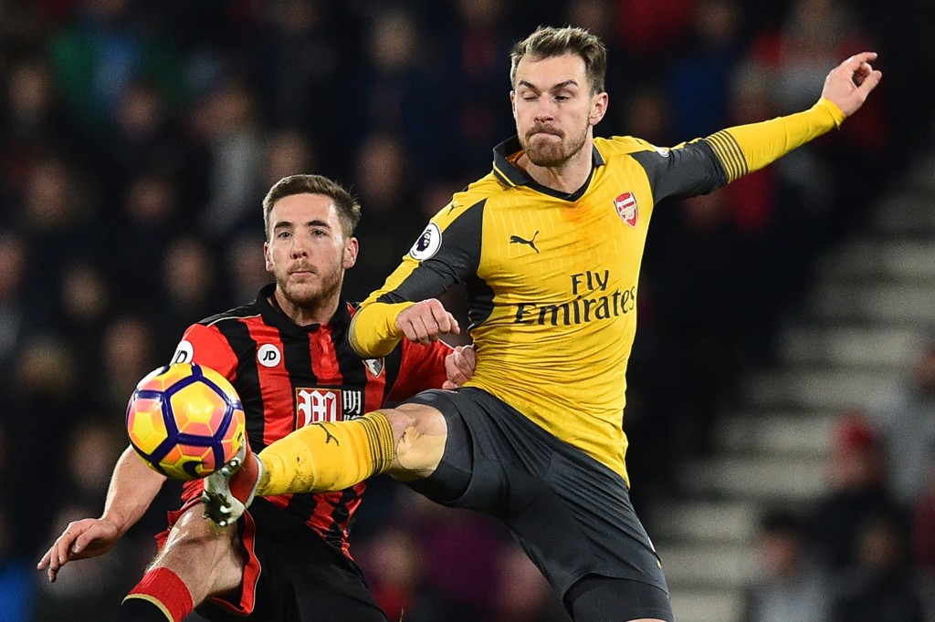 Arsenal's Welsh midfielder Aaron Ramsey (R) vies with Bournemouth's English midfielder Dan Gosling during the English Premier League football match between Bournemouth and Arsenal at the Vitality Stadium in Bournemouth, southern England on January 3, 2017. / AFP / Glyn KIRK / RESTRICTED TO EDITORIAL USE. No use with unauthorized audio, video, data, fixture lists, club/league logos or 'live' services. Online in-match use limited to 75 images, no video emulation. No use in betting, games or single club/league/player publications. / (Photo credit should read GLYN KIRK/AFP/Getty Images)