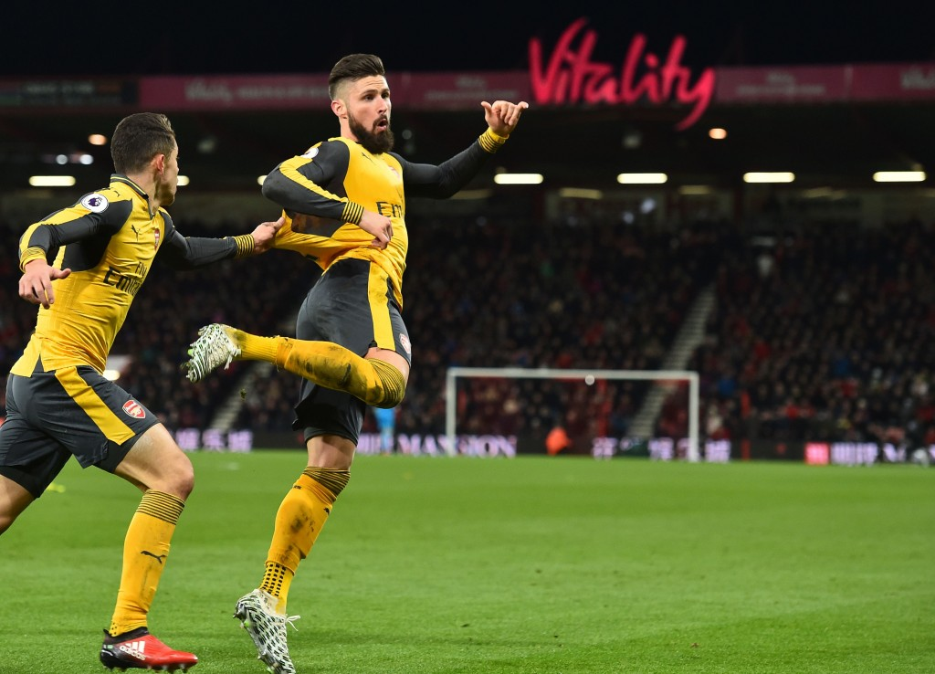 Arsenal's French striker Olivier Giroud celebrates after scoring their third goal during the English Premier League football match between Bournemouth and Arsenal at the Vitality Stadium in Bournemouth, southern England on January 3, 2017. / AFP / Glyn KIRK / RESTRICTED TO EDITORIAL USE. No use with unauthorized audio, video, data, fixture lists, club/league logos or 'live' services. Online in-match use limited to 75 images, no video emulation. No use in betting, games or single club/league/player publications. / (Photo credit should read GLYN KIRK/AFP/Getty Images)