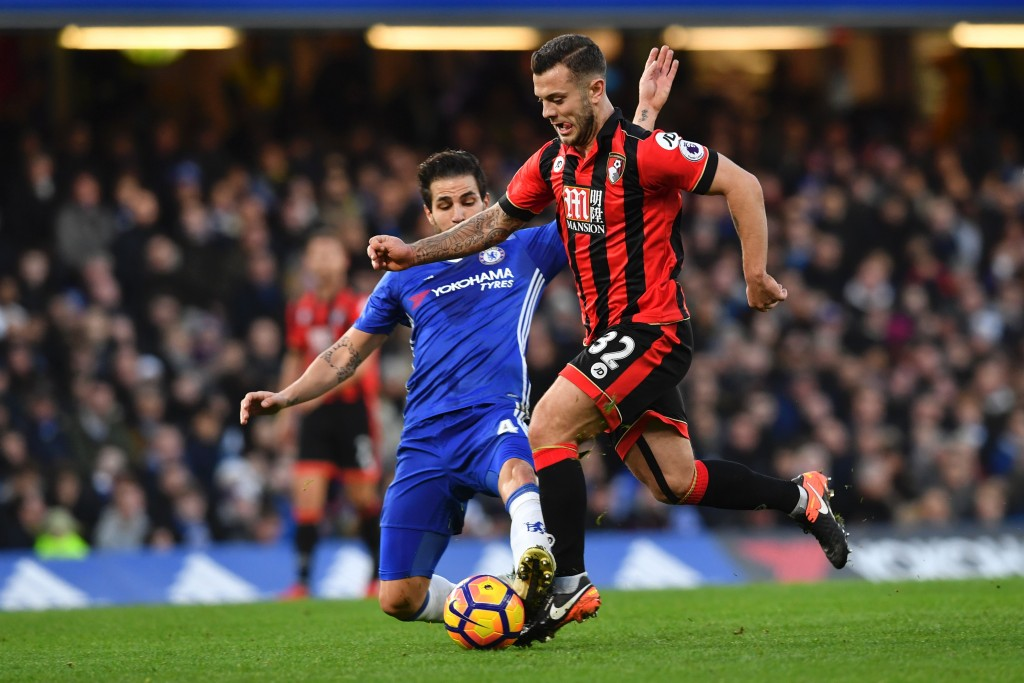 Chelsea's Spanish midfielder Cesc Fabregas (L) tackles Bournemouth's English midfielder Jack Wilshere (R) during the English Premier League football match between Chelsea and Bournemouth at Stamford Bridge in London on December 26, 2016. / AFP / Ben STANSALL / RESTRICTED TO EDITORIAL USE. No use with unauthorized audio, video, data, fixture lists, club/league logos or 'live' services. Online in-match use limited to 75 images, no video emulation. No use in betting, games or single club/league/player publications. / (Photo credit should read BEN STANSALL/AFP/Getty Images)
