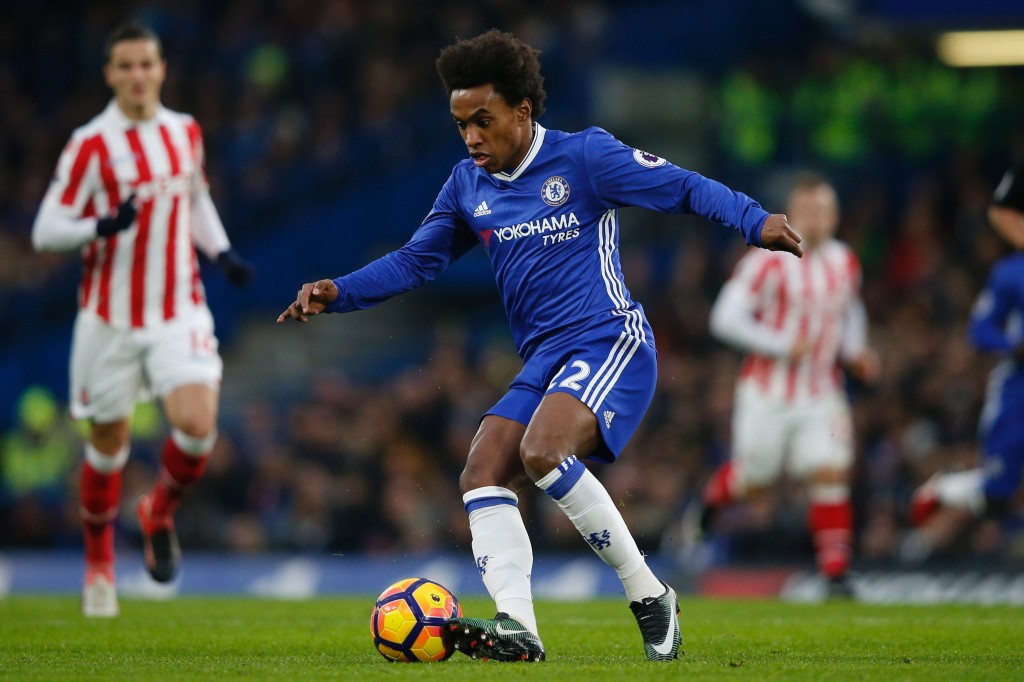 Chelsea's Brazilian midfielder Willian controls the ball during the English Premier League football match between Chelsea and Stoke City at Stamford Bridge in London on December 31, 2016. / AFP / Adrian DENNIS / RESTRICTED TO EDITORIAL USE. No use with unauthorized audio, video, data, fixture lists, club/league logos or 'live' services. Online in-match use limited to 75 images, no video emulation. No use in betting, games or single club/league/player publications. / (Photo credit should read ADRIAN DENNIS/AFP/Getty Images)
