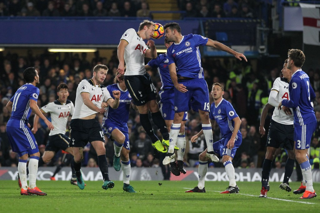 Tottenham Hotspur's English striker Harry Kane (CL) and Chelsea's Brazilian-born Spanish striker Diego Costa (CR) go up for a header during the English Premier League football match between Chelsea and Tottenham Hotspur at Stamford Bridge in London on November 26, 2016. (Photo by Ian Kington/AFP/Getty Images)