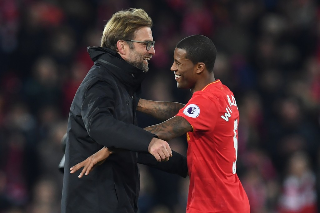 Liverpool's German manager Jurgen Klopp (L) celebrates on the pitch with goalscorer Liverpool's Dutch midfielder Georginio Wijnaldum after the English Premier League football match between Liverpool and Manchester City at Anfield in Liverpool, north west England on December 31, 2016. Liverpool won the game 1-0. / AFP / Paul ELLIS / RESTRICTED TO EDITORIAL USE. No use with unauthorized audio, video, data, fixture lists, club/league logos or 'live' services. Online in-match use limited to 75 images, no video emulation. No use in betting, games or single club/league/player publications. / (Photo credit should read PAUL ELLIS/AFP/Getty Images)
