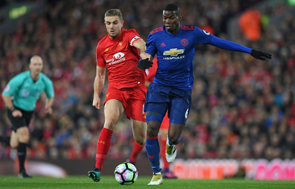 Liverpool's English midfielder Jordan Henderson vies with Manchester United's French midfielder Paul Pogba (R) during the English Premier League football match between Liverpool and Manchester United at Anfield in Liverpool, north west England on October 17, 2016. (Photo courtesy - Paul Ellis/AFP/Getty Images)