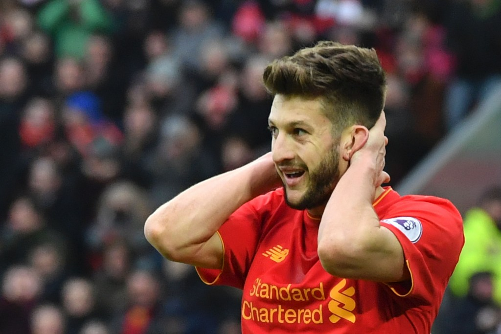 Liverpool's English midfielder Adam Lallana reacts after a missed chance during the English Premier League football match between Liverpool and Swansea City at Anfield in Liverpool, north west England on January 21, 2017. (Photo by Anthony Devlin/AFP/Getty Images)