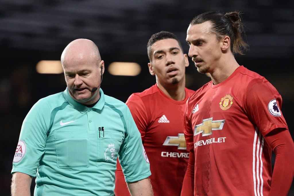 Manchester United's Swedish striker Zlatan Ibrahimovic (R) remonstrates with English referee Lee Mason, after Mason disallowed his goal, during the English Premier League football match between Manchester United and Middlesbrough at Old Trafford in Manchester, north west England, on December 31, 2016. (Photo by Oli Scarff/AFP/Getty Images)