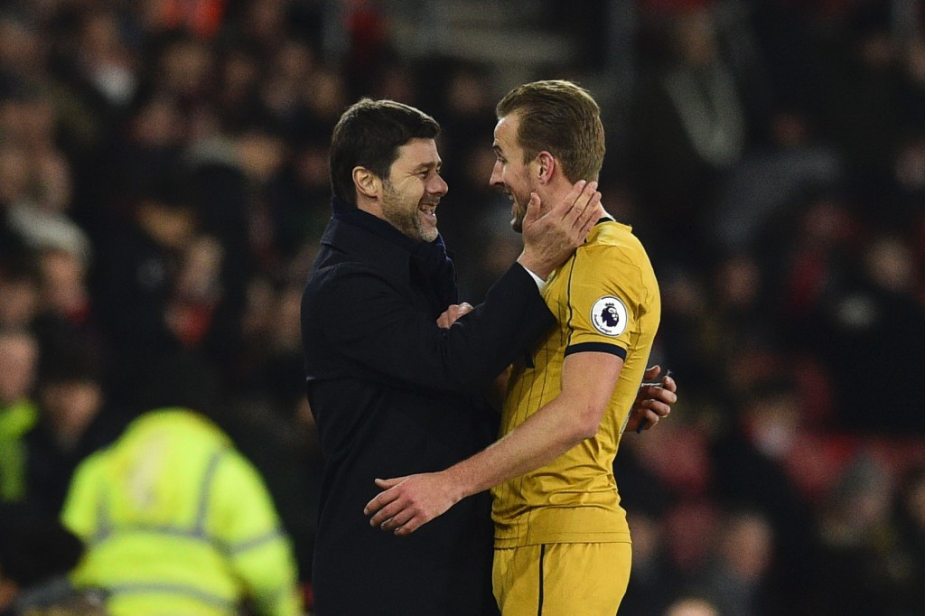 Tottenham Hotspur's Argentinian head coach Mauricio Pochettino (L) embraces Tottenham Hotspur's English striker Harry Kane (R) as he leaves the field substituted during the English Premier League football match between Southampton and Tottenham Hotspur at St Mary's Stadium in Southampton, southern England on December 28, 2016. (Photo by Glyn Kirk/AFP/Getty Images)