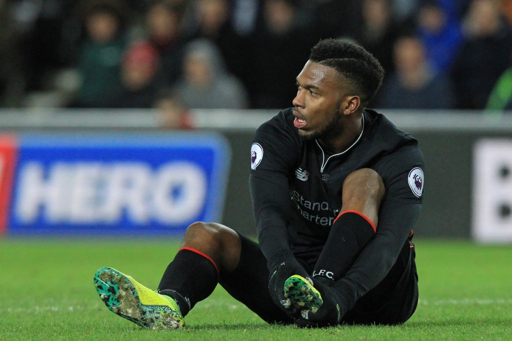 Liverpool's English striker Daniel Sturridge holds his foot after appearing to pick up an injury during the English Premier League football match between Sunderland and Liverpool at the Stadium of Light in Sunderland, north-east England on January 2, 2017. The game finished 2-2. / AFP / Lindsey PARNABY / RESTRICTED TO EDITORIAL USE. No use with unauthorized audio, video, data, fixture lists, club/league logos or 'live' services. Online in-match use limited to 75 images, no video emulation. No use in betting, games or single club/league/player publications. / (Photo credit should read LINDSEY PARNABY/AFP/Getty Images)