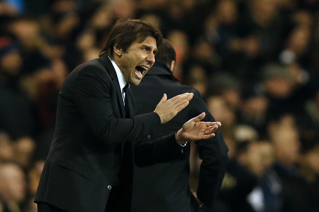 Chelsea's Italian head coach Antonio Conte gestures on the touchline during the English Premier League football match between Tottenham Hotspur and Chelsea at White Hart Lane in London, on January 4, 2017. In-form midfielder Dele Alli scored two near-identical headers as Tottenham Hotspur beat Chelsea 2-0 on Wednesday to torpedo the Premier League leaders' hopes of a record 14th consecutive victory. (Photo by Adrian Dennis/AFP/Getty Images)