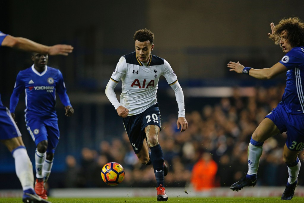 Tottenham Hotspur's English midfielder Dele Alli runs with the ball during the English Premier League football match between Tottenham Hotspur and Chelsea at White Hart Lane in London, on January 4, 2017. / AFP / Adrian DENNIS / RESTRICTED TO EDITORIAL USE. No use with unauthorized audio, video, data, fixture lists, club/league logos or 'live' services. Online in-match use limited to 75 images, no video emulation. No use in betting, games or single club/league/player publications. / (Photo credit should read ADRIAN DENNIS/AFP/Getty Images)