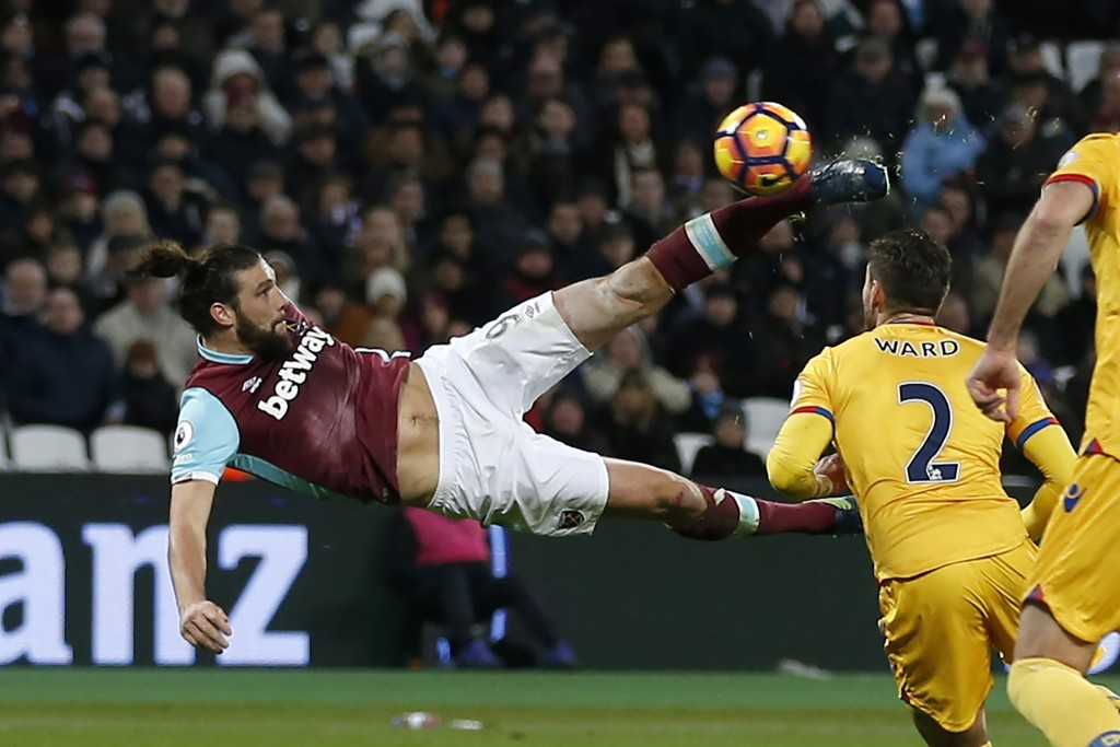 West Ham United's English striker Andy Carroll shoots to score their second goal with this bicycle kick during the English Premier League football match between West Ham United and Crystal Palace at The London Stadium, in east London on January 14, 2017. (Photo by Ian Kington/AFP/Getty Images)