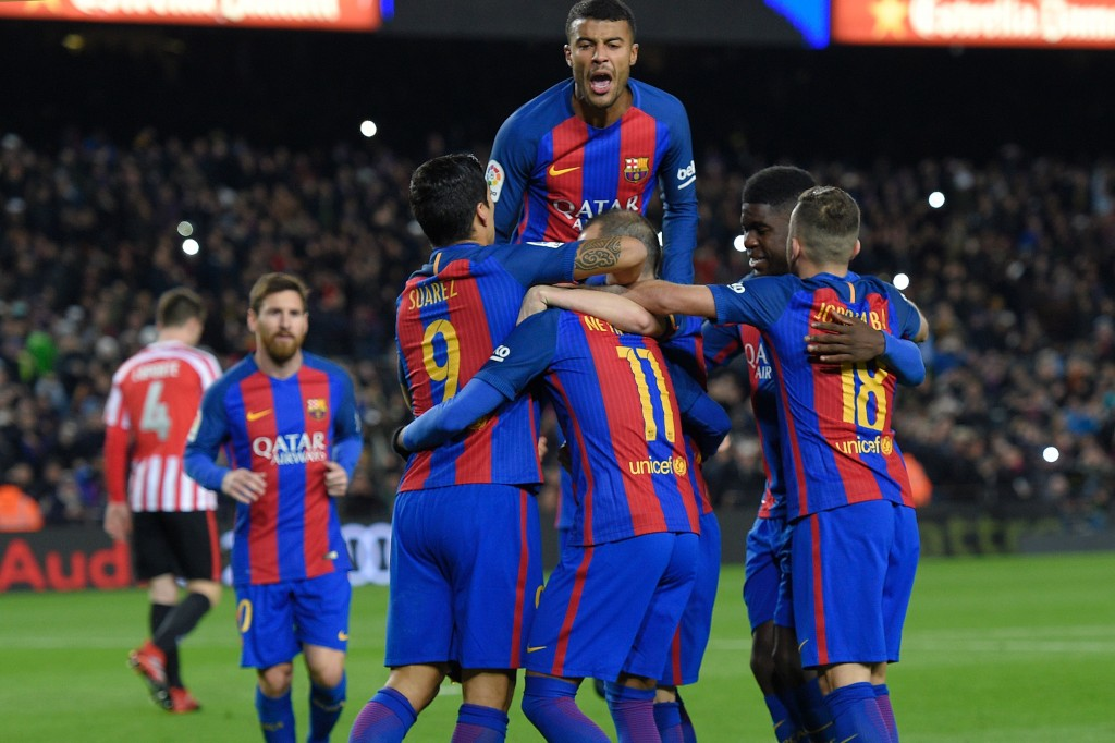 Barcelona's players celebrate after scoring a goal during the Spanish Copa del Rey (King's Cup) round of 16 second leg football match FC Barcelona vs Athletic Club de Bilbao at the Camp Nou stadium in Barcelona on January 11, 2017. / AFP / LLUIS GENE (Photo credit should read LLUIS GENE/AFP/Getty Images)