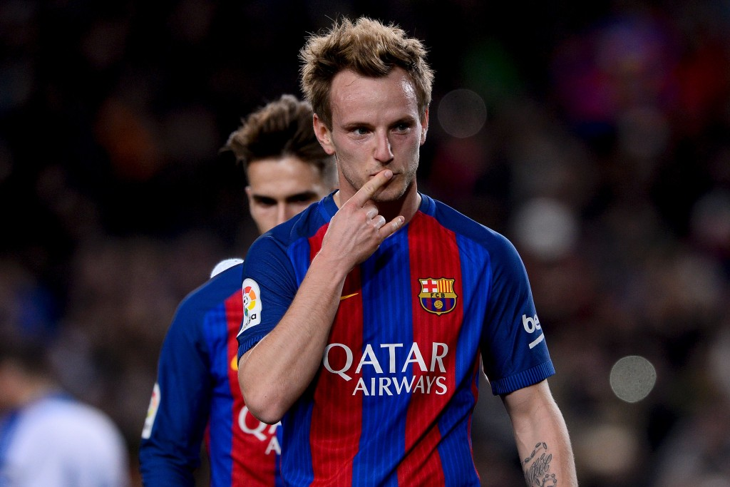 Barcelona's Croatian midfielder Ivan Rakitic celebrates after scoring during the Spanish Copa del Rey (King's Cup) round of 32 second leg football match FC Barcelona vs Hercules CF at the Camp Nou stadium in Barcelona on December 21, 2016. / AFP / JOSEP LAGO (Photo credit should read JOSEP LAGO/AFP/Getty Images)