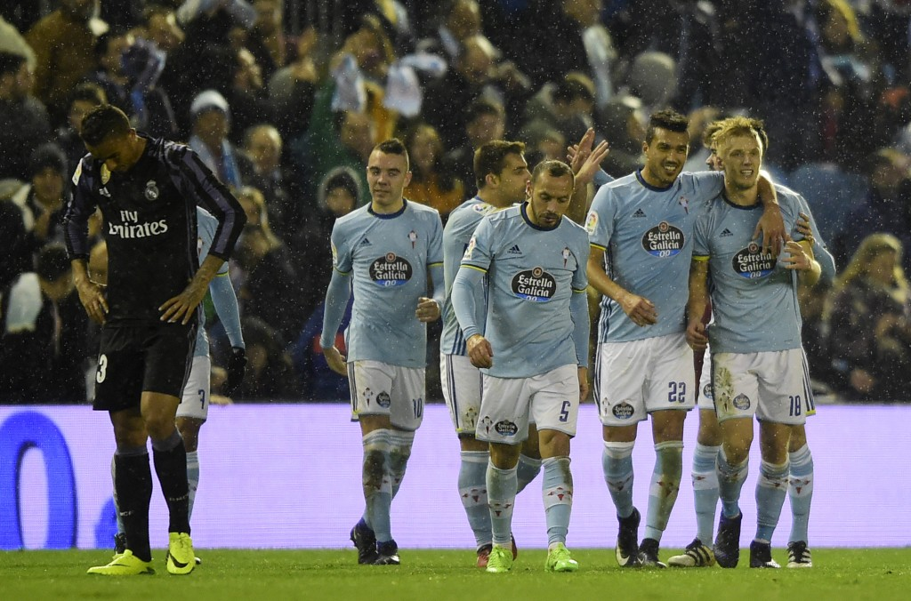 Celta Vigo's Danish midfielder Daniel Wass (R) celebrates with teammates after scoring during the Spanish Copa del Rey (King's Cup) quarter final second leg football match RC Celta de Vigo vs Real Madrid CF RC Celta de Vigo on January 25, 2017. A fine free-kick from Cristiano Ronaldo couldn't prevent Real Madrid from being dumped out of the Copa del Rey as a 2-2 draw at Celta Vigo today allowed the hosts to progress to the semi-finals 4-3 on aggregate. / AFP / MIGUEL RIOPA (Photo credit should read MIGUEL RIOPA/AFP/Getty Images)