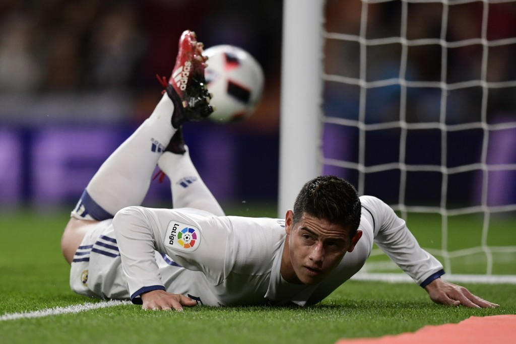 Real Madrid's Colombian midfielder James Rodriguez lies on the ground as he celebrates after scoring during the Spanish Copa del Rey (King's Cup) Round of 32 second leg football match Real Madrid CF vs Cultural y Deportiva Leonesa at the Santiago Bernabeu stadium in Madrid on November 30, 2016. (Photo by Javier Soriano/AFP/Getty Images)