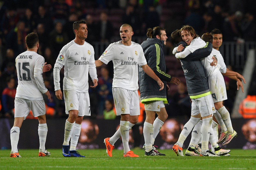 "Madrid's players celebrate after winning the Spanish league ""Clasico"" football match FC Barcelona vs Real Madrid CF at the Camp Nou stadium in Barcelona on April 2, 2016. / AFP / LLUIS GENE (Photo credit should read LLUIS GENE/AFP/Getty Images)"