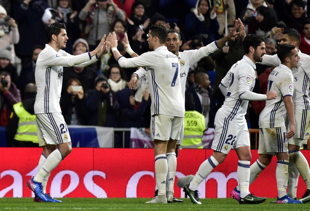 Real Madrid's forward Alvaro Morata is congratuled by Real Madrid's Portuguese forward Cristiano Ronaldo (2L) after scoring a goal during the Spanish league football match Real Madrid CF vs Real Sociedad at the Santiago Bernabeu stadium in Madrid on January 29, 2017. / AFP / GERARD JULIEN (Photo credit should read GERARD JULIEN/AFP/Getty Images)