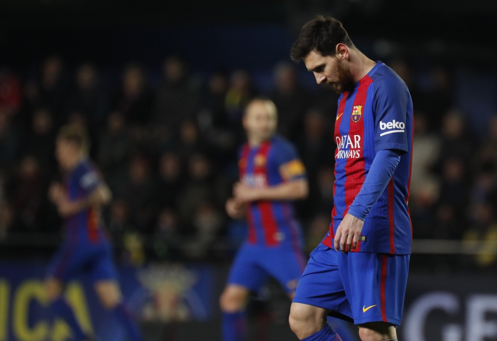 Barcelona's Argentinian forward Lionel Messi reacts after missing an attempt on goal during the Spanish league football match Villarreal CF vs FC Barcelona at El Madrigal stadium in Vila-real on January 8, 2017. / AFP / JOSE JORDAN (Photo credit should read JOSE JORDAN/AFP/Getty Images)