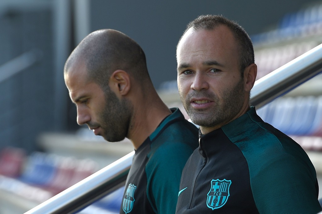 Barcelona's midfielder Andres Iniesta (R) and Barcelona's Argentinian defender Javier Mascherano arrive for a training session at the Sports Center FC Barcelona Joan Gamper in Sant Joan Despi, near Barcelona on October 18, 2016, on the eve of the UEFA Champions League football match FC Barcelona vs Manchester City. / AFP / LLUIS GENE (Photo credit should read LLUIS GENE/AFP/Getty Images)
