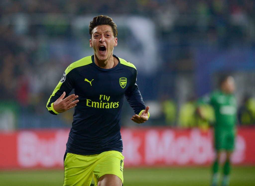 Arsenals German midfielder Mesut Ozil celebrates after scoring a goal during the UEFA Champions League Group A football match between PFC Ludogorets and Arsenal, on November 1, 2016 at the Vassil Levski stadium in Sofia. / AFP / NIKOLAY DOYCHINOV (Photo credit should read NIKOLAY DOYCHINOV/AFP/Getty Images)