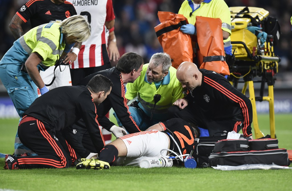 Manchester's defender Luke Shaw receives treatment for a double fracture of the leg during the UEFA Champions League Group B football match between PSV Eindhoven and Manchester United at the Philips stadium in Eindhoven, the Netherlands on September 15, 2015. PSV Eindhoven defeated Manchester 2-1. AFP PHOTO / JOHN THYS (Photo credit should read JOHN THYS/AFP/Getty Images)