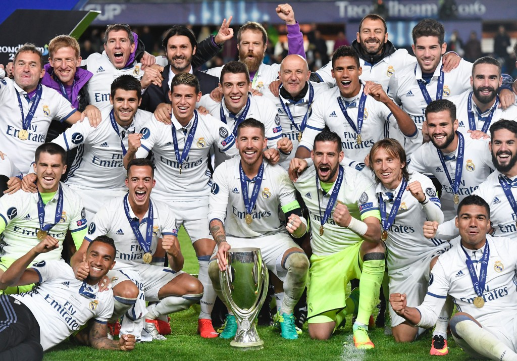 Real Madrid's players celebrate with the trophy after winning the UEFA Super Cup final football match between Real Madrid CF and Sevilla FC on August 9, 2016 at the Lerkendal Stadion in Trondheim. / AFP / JONATHAN NACKSTRAND (Photo credit should read JONATHAN NACKSTRAND/AFP/Getty Images)